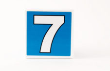 Number 7 in  a simple child building block on white
